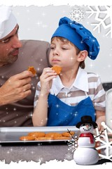 Composite image of father and son eating cookies