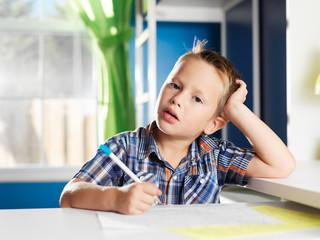 little boy bored with homework
