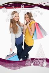 Beautiful young women with shopping bags the thumbup