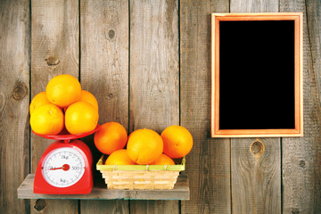 Orange on scales and in a basket