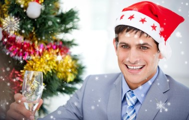 Composite image of businessman celebrating christmas