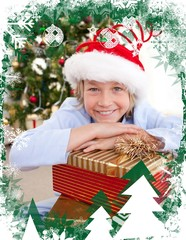 Composite image of happy little boy with christmas presents