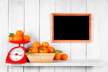 Tangerines on scales and in a basket
