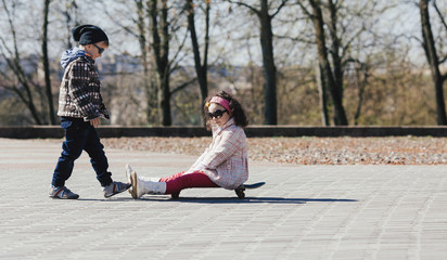 boy and girl skating on the street