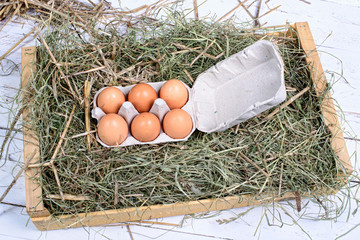 carton of six eggs in the straw