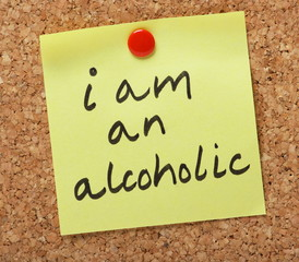 The phrase I am an alcoholic written on a sticky note