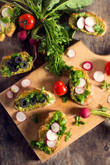Bruschettas with pesto sauce and vegetables