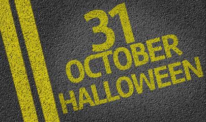 October 31 Halloween written on the road