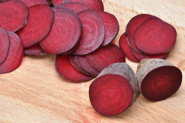 Slices of red beet on board