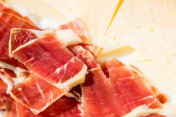 cut slices of ham (panish jamon iberico) and cheese