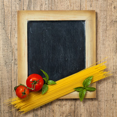 Pasta, Tomatoes, Basil on black chalkboard