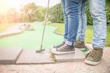 Fototapety Couple at mini golf club