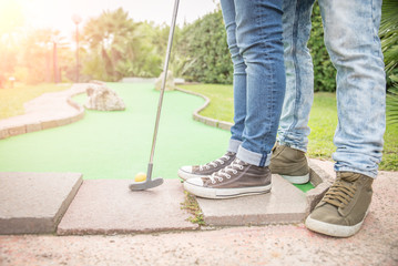 Couple at mini golf club