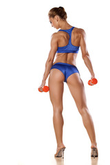 handsome muscular woman with weights, posing on a white