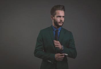 Business fashion man wearing green suit with blue shirt and blac