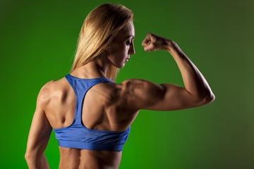 Young lady showing her muscular shoulders and biceps