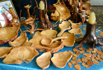 Sale of products from a cap and roots of trees at fair of nation