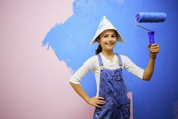Renovation of the house - young girl  painting wall