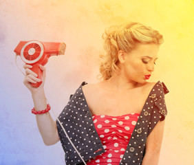 Beautiful girl with retro hairdryer