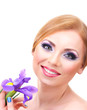 Beautiful young woman with glamour make up and flower, isolated