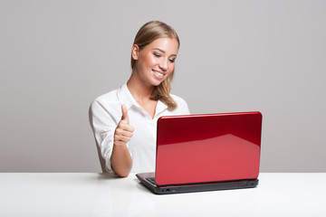 Young blond with her computer.