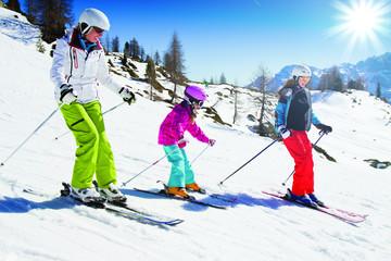 Skiing, skiers on mountainside