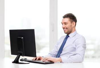 smiling businessman or student with computer