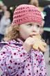 Sweet little girl eating gingerbread