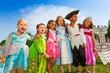 Children diversity in festival costumes standing
