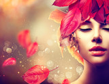 Fototapety Autumn Woman. Fall. Girl with colourful autumn leaves hairstyle