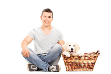 Man sitting with a cute puppy on the floor