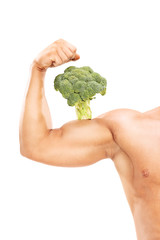 Muscular arm with a broccoli on the bicep