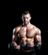 Man doing biceps curls in gym.