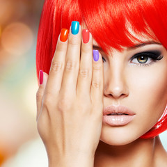 Woman with colored nails of fingers