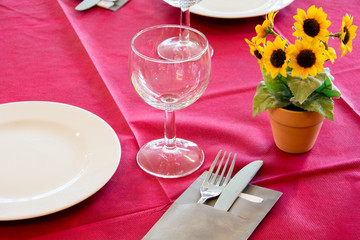 Setting red table with a sunflower