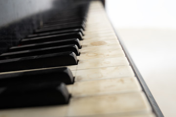 Low angle view of an old piano keyboard