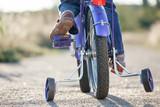 Kids bike with training wheels closeup