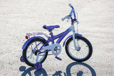 Small kids bike with training wheels outdoors. poster