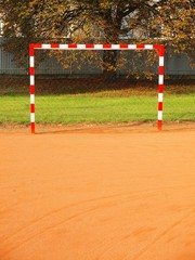 Empty gate. Outdoor football or handball playground, light red