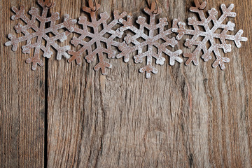 Snowflakes on grunge wood