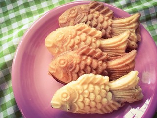 Taiyaki japanese pancake in fish shape with retro filter effect