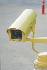 yellow CCTV security camera