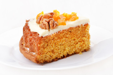 Piece of carrot cake on white plate
