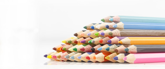 heap of color pencils against  white