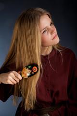 Scandinavian cute young girl portrait brushing