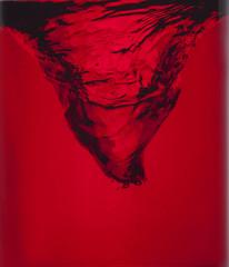 swirl of red liquid small typhoon