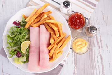 ham, french fries and salad