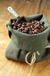 roasted coffee beans in a bag with ceramic scoop