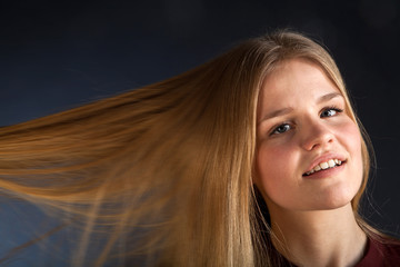 Scandinavian cute young girl portrait playing with her hair