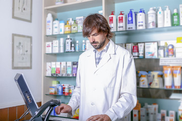 pharmacist working with the computer